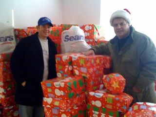 Handing over the gifts to Al's Angels, Al DiGuido
